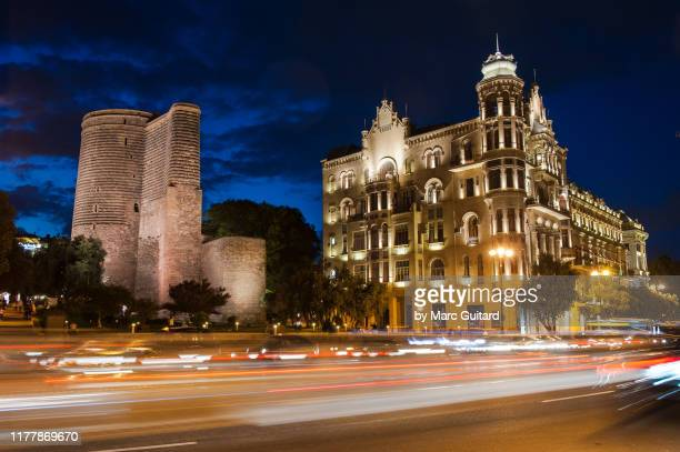 the maiden tower at night, baku, azerbaijan - baku stock pictures, royalty-free photos & images