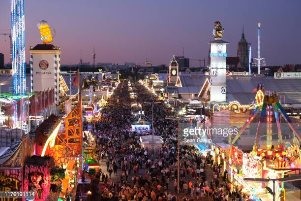 The main avenue lined with beer tents stands illuminated on the first day of the 2019 Oktoberfest on September 21 2019 in Munich Germany This year's...