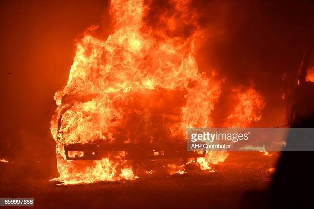 The main building at Paras Vinyards burns in the Mount Veeder area of Napa in California on October 10 2017 Firefighters battled wildfires in...
