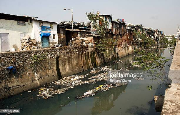 The main canal in Dharavi November 4 2011 in Mumbai India Dharavi Asia's largest slum situated in the centre of Mumbai One million people live and...