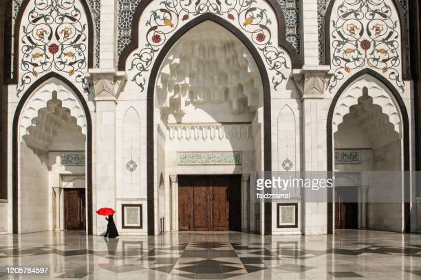 the main enterance of federal territory mosque, kuala lumpur - mosque stock pictures, royalty-free photos & images