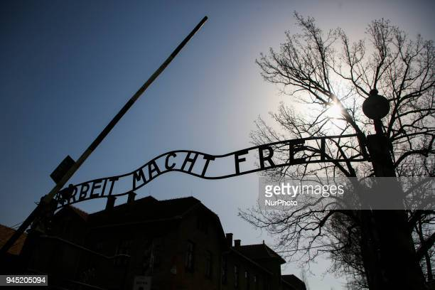 The main entrance gate bearing the inscription 'Arbeit Macht Frei' at the former NaziGerman Auschwitz I concentration and extermination camp at...