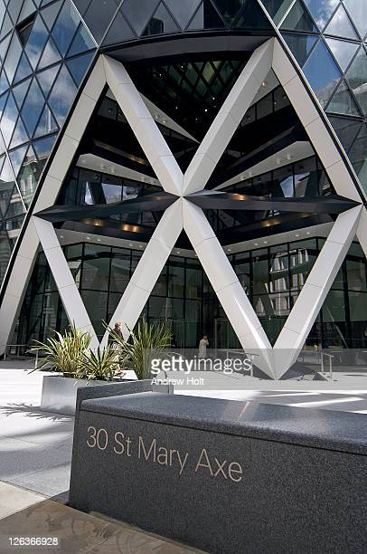 The main entrance to 30 St Mary Axe, more affectionately known as the Gherkin or the Swiss Re Tower. It is 590 ft (180 m) tall, making it the 2nd tallest building in the City of London, after Tower 42, and the 6th tallest in London as a whole. The design i