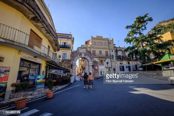 the main entrance to the old city of taormina in sicily italy - finn bjurvoll stock pictures, royalty-free photos & images