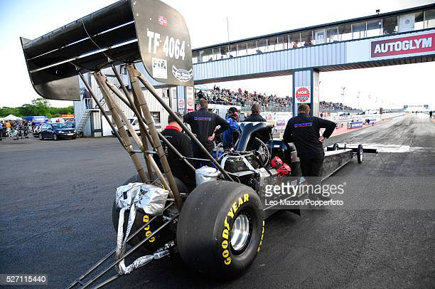 The Main Event FIA European Drag Racing Finals Santa Pod Raceway Northampton UK Dennis Habermann GER and crew awaiting their rain delayed start in...