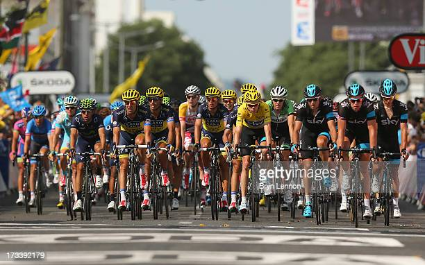 The main field arrive safely to the finish line inclusing the current race leader and wearer of the Maillot Jaune, Chris Froome of Great Britain and...