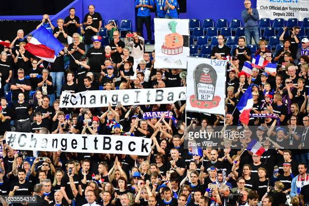The main France team supporters group hold up banners protesting the new format for the Davis Cup during Day 2 of the Davis Cup semi final on...