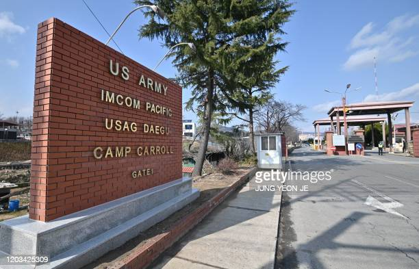 The main gate of US Army Camp Carroll is seen in Chilgok, about 30 kilometres north of Daegu, on February 26, 2020. - An American soldier stationed...