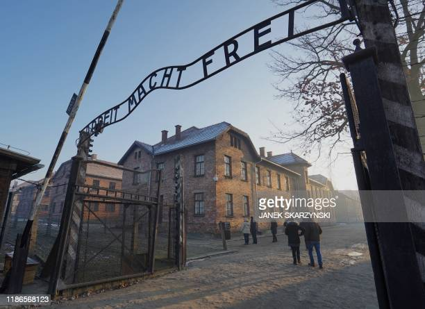 "The main gate with the inscription ""Arbeit macht frei"" at the entrance to the Auschwitz German Nazi death camp is pictured ahead of German Chancellor..."