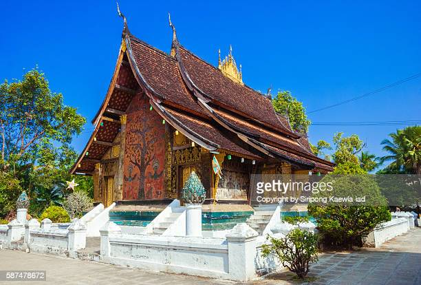 The main hall of Wat Xieng Thong from the rear with blue sky in background