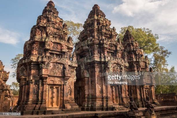 the main holy tower of banteay srei temple the most beautiful pink sandstone temple in siem reap, cambodia. - banteay srei stock pictures, royalty-free photos & images