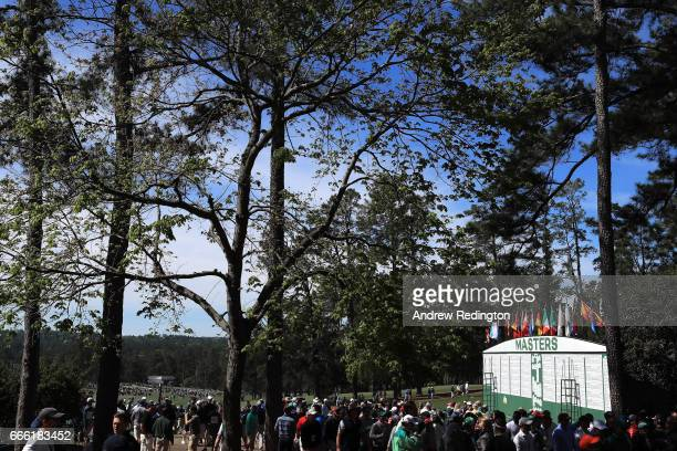 The main leaderboard near the first hole is seen as patrons enter the course during the third round of the 2017 Masters Tournament at Augusta...