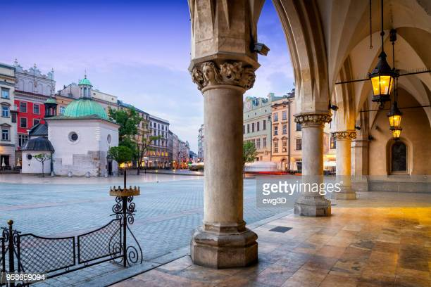 the main market square of krakow in the morning, poland - polish culture stock photos and pictures