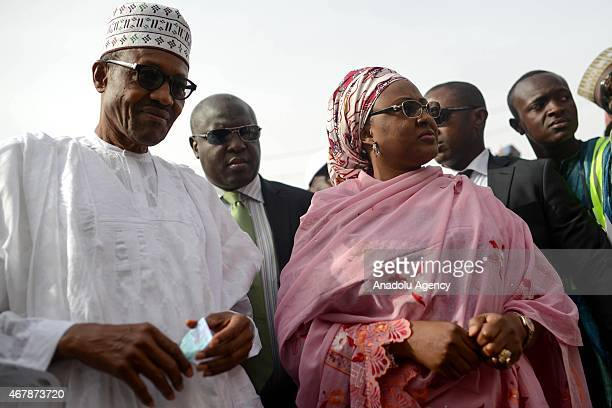 The main opposition All Progressives Congress presidential candidate Mohammadu Buhari and his wife Aisha Halilu arrive for registration at Gidan...