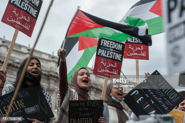 The main road is blocked as thousands of people attend a protest and block Whitehall to demonstrate against the Israeli bombing of Gaza and...