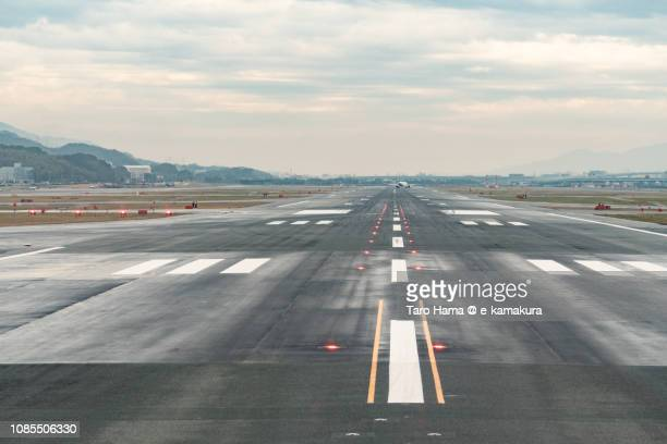 the main runaway of fukuoka international airport (fuk)  in japan - runway stock pictures, royalty-free photos & images