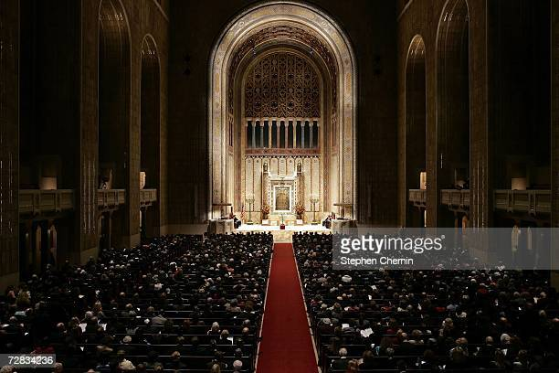 The main sanctuary is full during the first night of Hanukkah at Congregation EmanuEl December 15 2006 in New York City The Hanukkah celebration also...