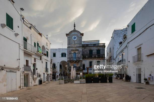 the main square at cisternino - cisternino stock photos and pictures