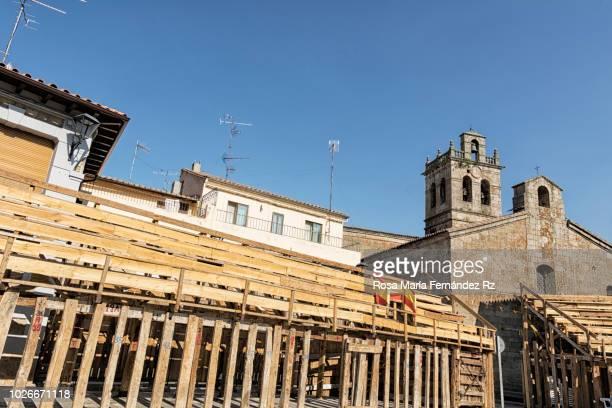 The main square of the village used as the bullring (Plaza de toros), and parish Church of Nuestra Señora de la Asunción,  Fermoselle, Zamora, Castilla y León, Spain