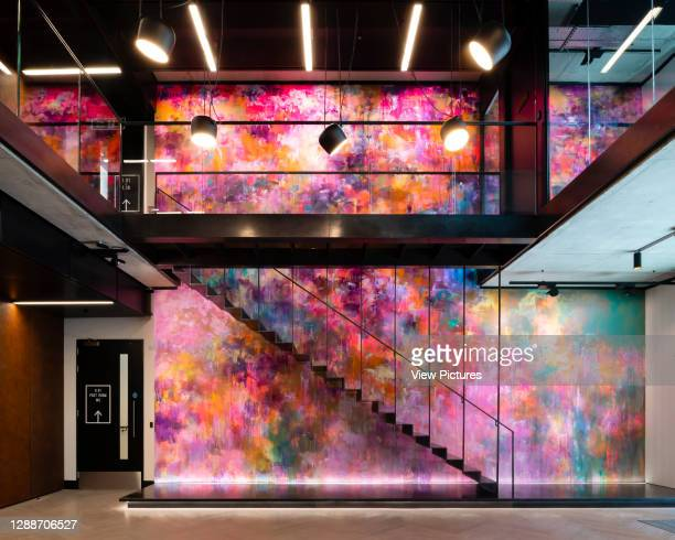 The main stairs featuring a mural by Mr. Jago. The Frames, London, United Kingdom. Architect: Squire and Partners, 2018.
