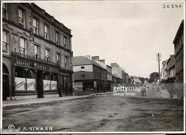 The main street at Fermoy showing the demolished storefronts Note the barbed wire used in the upper half of the windows