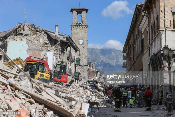 The main street of the city with the ancient tower and the houses completely collapsed after the earthquake that hit the city of Amatrice in central...