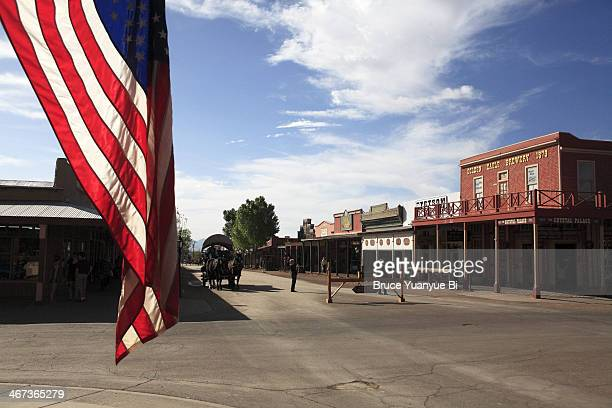 the main street of tombstone with us flag - tombstone arizona stock pictures, royalty-free photos & images