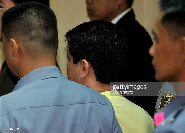 The main suspect in the Philippines' worst massacre Andal Ampatuan Jnr appears for his trial inside a maximum security facility in Taguig suburban...