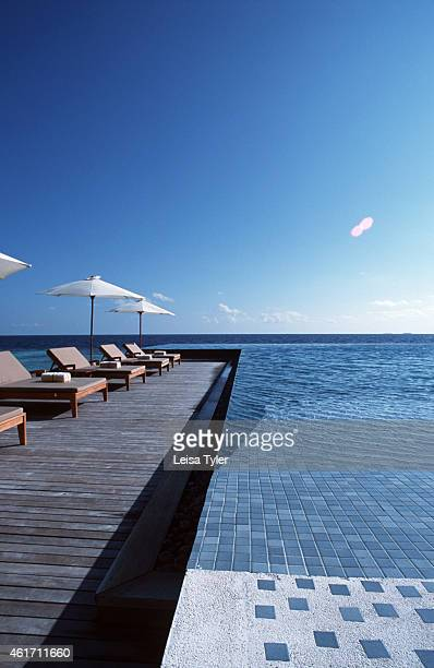 The main swimming pool at Huvafenfushi a new resort on Male Atoll the Maldives Classified as six stars Huvafenfushi is one of many super deluxe...