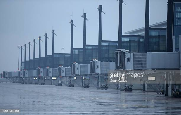 The main terminal of the construction site of the new Willy Brandt Berlin Brandenburg International Airport stands under rainy weather on November 1...