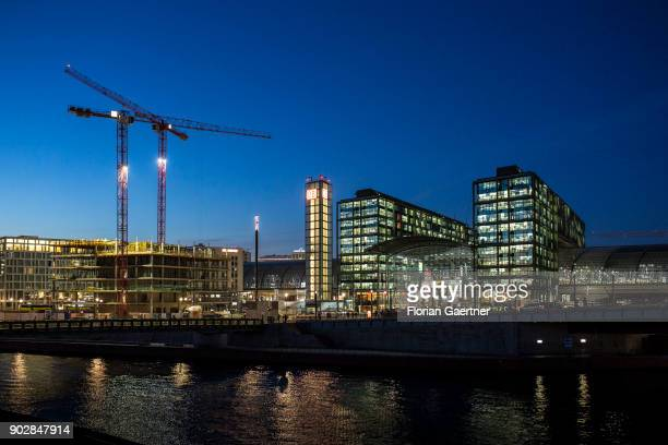 The main train station and the river Spree are pictured during the blue hour on January 08 2018 in Berlin Germany