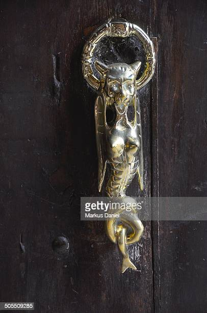 CONTENT] The main wooden door portico entrance metallic door knocker at Torre Tagle Palace in old historic downtown Lima Peru Torre Tagle Palace is a...