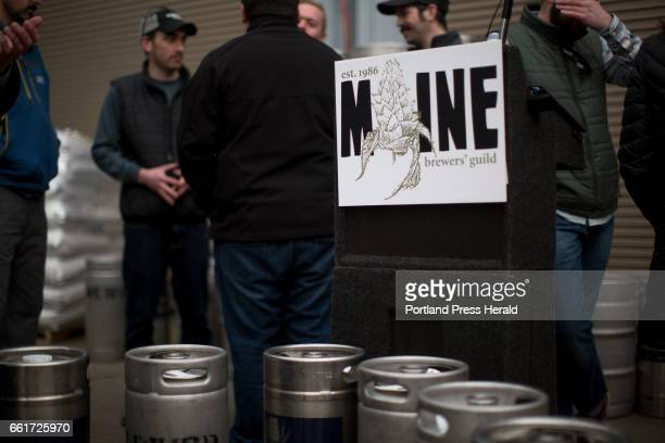 The Maine Brewers' Guild sign surrounded by kegs of craft beer at the press conference about Eimskip and the Maine Brewers' Guild's new partnership