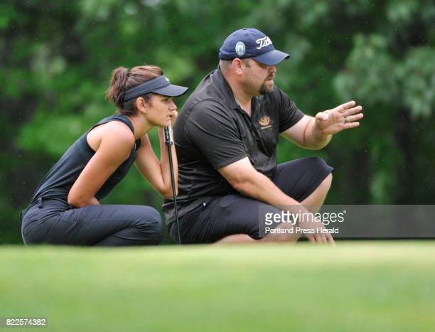 The Maine Women's Amateur golf tournament's opening day Elizabeth Lacognata gets some advise from caddie Dan Allen on the 18th green Lacognata's 74...