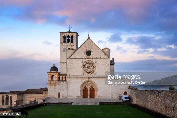 the majestic basilica of san francesco in assisi, italy. photographed from above at dawn - basilica stock pictures, royalty-free photos & images