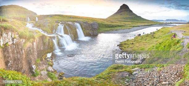 the majestic kirkjufell with solo traveller takeing a photo in summer, iceland - equirectangular panorama stock pictures, royalty-free photos & images