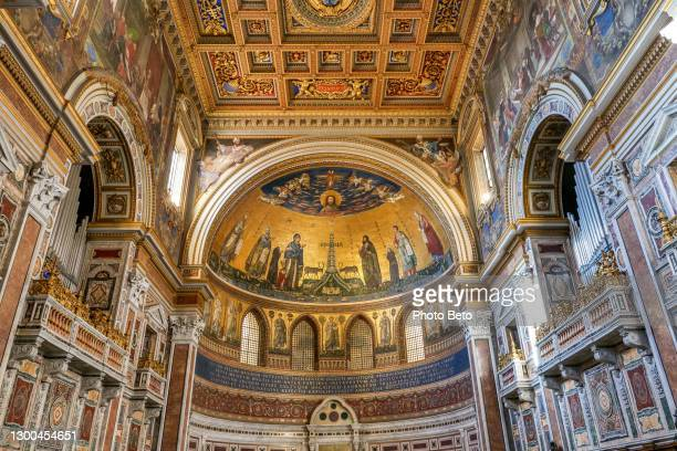the majestic main apse with mosaics inside the basilica of san giovanni in laterano in rome - madonna singer stock pictures, royalty-free photos & images