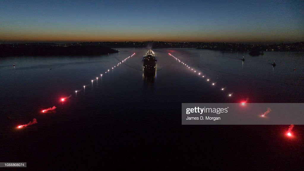 The Majestic Princess ship travels down a floating runway at Sydney Harbour on September 15, 2018 in Sydney, Australia. Australia's summer cruise season took off with a spectacular touch down by the international superliner Majestic Princess being the largest Princess cruise ship to ever visit Australia. She sailed into her new homeport alongside a 1550 meter long illuminated runway consisting of 62 buoys with red and white flares. At 143,700 tonnes the ship is equivalent to 126 Sydney Manly ferries and her height of more than 68 meters makes her taller than the Sydney Opera House.