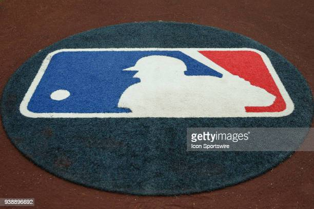 The Major League Baseball logo on the on deck circle during the spring training MLB baseball game between the Cleveland Indians and the Arizona...