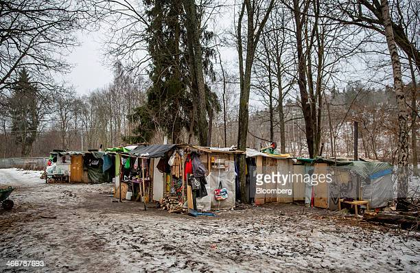 The makeshift shelters of EU migrants and asylum seekers form a temporary encampment on a forested hillside in Stockholm Sweden on Monday Feb 3 2014...