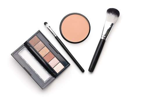 The makeup products. Brush and eyeshadow powder isolated on white background. 1093679864