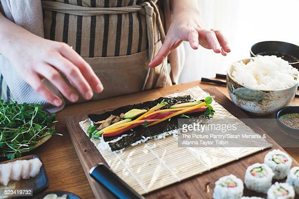 The making of sushi. Rolled sushi preparation.