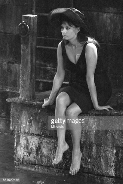 The making of The Millionairess Film 15th July 1960 Pictured Sophia Loren Italian Actress on set sitting by the water during filming Plot Summary...