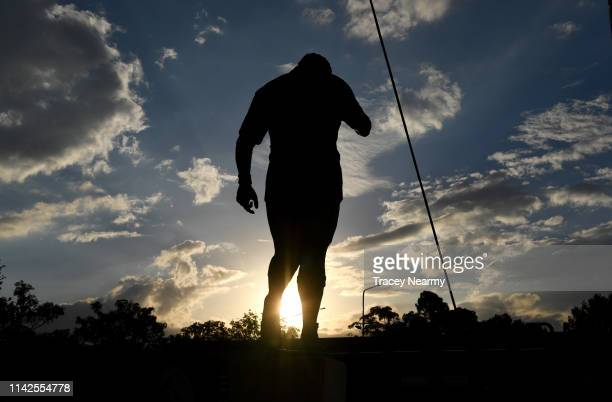The Mal Meninga statue is silhouetted before the Round 5 Canberra Raiders and Parramatta Eels match at GIO Stadium on April 14 2019 in Canberra...