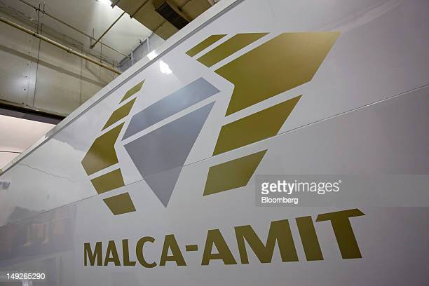 The MalcaAmit Global Ltd logo is displayed on the side of an armored transport vehicle at the company's new gold storage facility in Hong Kong China...