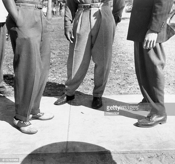 The male college students wear zoot suits about the campus of BethuneCookman College in Daytona Beach Florida January 1943 | Location BethuneCookman...