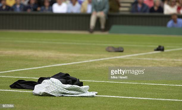 The male streaker's clothes are left on Centre Court during the Mens Singles Final at the All England Tennis Championships at the All England Lawn...