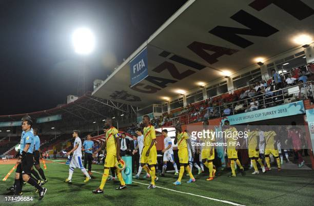 The Mali and Greece players walk onto the pitch before the FIFA U20 World Cup Group D match between Mali and Greece at Kamil Ocak Stadium on June 25...