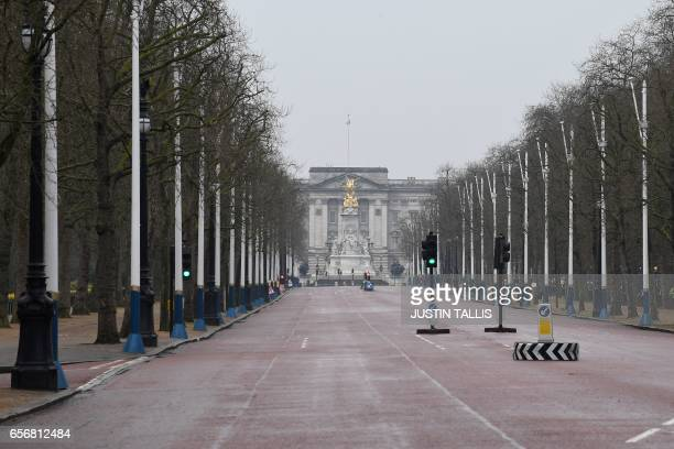 The Mall leading toward Buckingham Palace in central London is empty and closed to traffic on March 23 2017 the day after the March 22 terror attack...