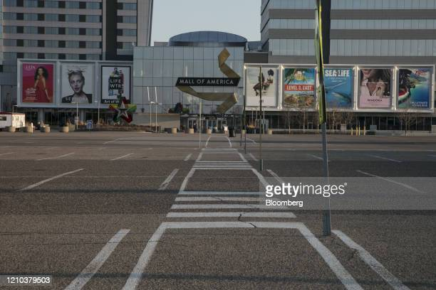 The Mall of America parking lot sits empty in Bloomington, Minnesota, U.S., on Saturday, April 18, 2020. Governor Tim Walz of Minnesota, a state that...